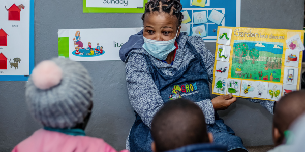 Reading books to children at GROW Educare ECD Classroom